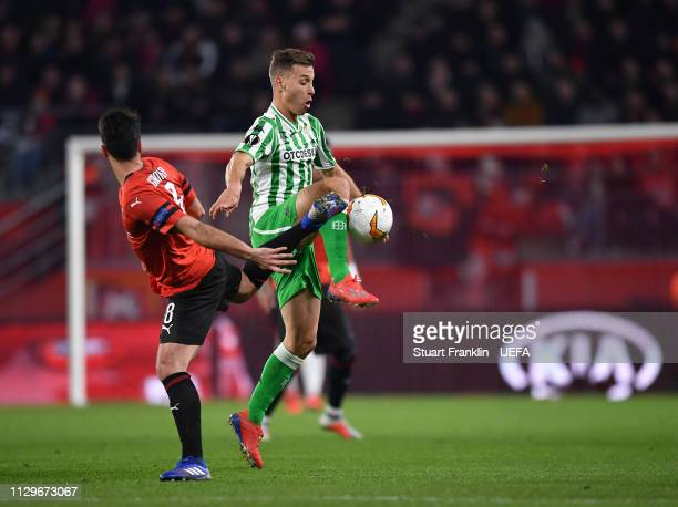 Clement Grenier of Rennes is challenged by Sergio Caneles of Betis during the UEFA Europa League Round of 32 First Leg match between Stade Rennais...