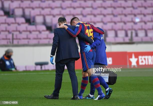 Clement Lenglet of Barcelona walks off injured during the La Liga Santander match between FC Barcelona and C.A. Osasuna at Camp Nou on November 29,...
