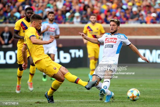 Clement Lenglet of FC Barcelona and Dries Mertens of SSC Napoli battle for the ball during the 2019 International Champions Cup match at Michigan...