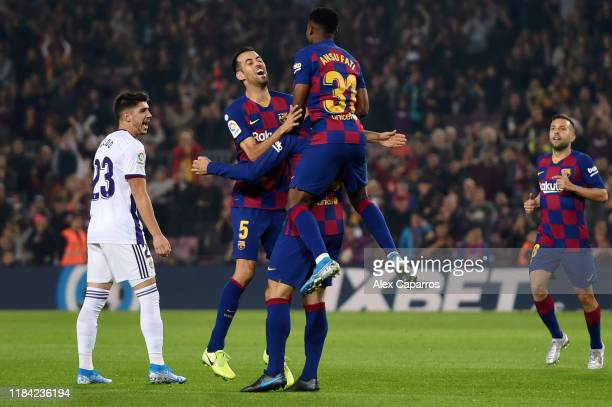 Clement Lenglet of FC Barcelona celebrates after scoring his team's first goal with Sergio Busquets and Anssumane Fati of FC Barcelona during the...