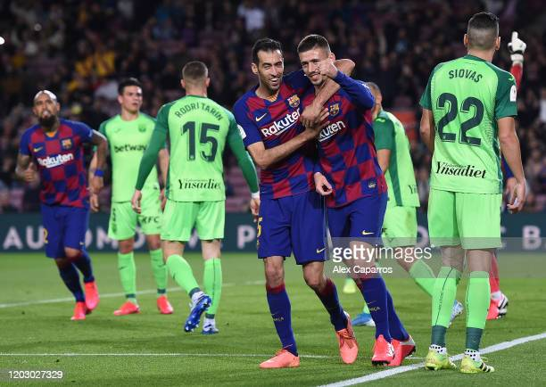 Clement Lenglet of FC Barcelona celebrates with team mate Sergio Busquets of FC Barcelona after scoring the second goal during the Copa del Rey Round...