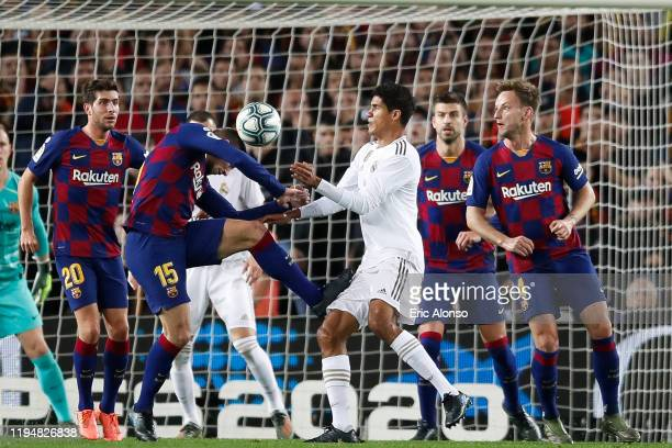 Clement Lenglet of FC Barcelona challenges against Raphael Varane of Real Madrid during the Liga match between FC Barcelona and Real Madrid CF at...