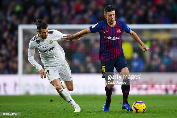 Clement Lenglet of FC Barcelona competes for the ball with Gareth Bale of Real Madrid CF during the La Liga match between FC Barcelona and Real...