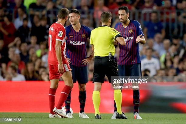 Clement Lenglet of FC Barcelona receives a red card from referee Gil Manzano during the La Liga Santander match between FC Barcelona v Girona at the...