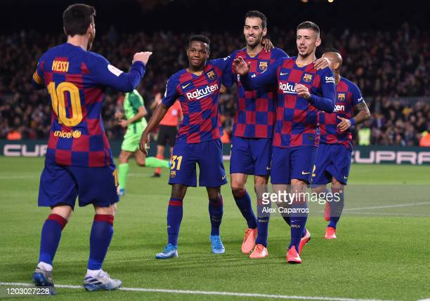 Clement Lenglet of FC Barcelona runs to celebrate with Lionel Messi of FC Barcelona after scoring the second goal during the Copa del Rey Round of 16...