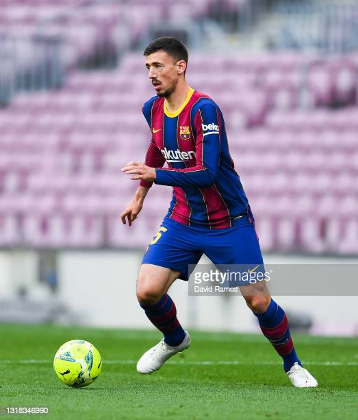 Clement Lenglet of FC Barcelona runs with the ball during the La Liga Santander match between FC Barcelona and RC Celta at Camp Nou on May 16, 2021...