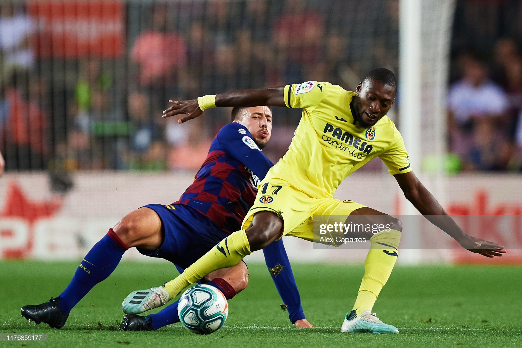صور مباراة : برشلونة - فياريال 2-1 ( 24-09-2019 )  Clement-lenglet-of-fc-barcelona-tackles-toko-ekambi-of-villarreal-cf-picture-id1176859177?s=2048x2048