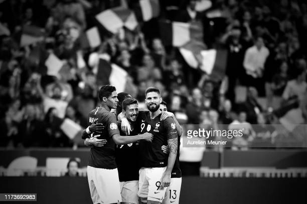 Clement Lenglet of France is congratulated by teammates Raphael Varane and Olivier Giroud after scoring during UEFA Euro 2020 qualifier match between...
