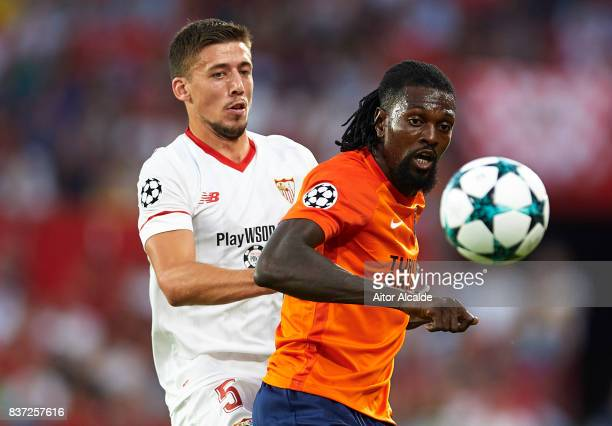 Clement Lenglet of Sevilla FC competes for the ball with Emmanuel Adebayor of Istanbul Basaksehir during the UEFA Champions League Qualifying...