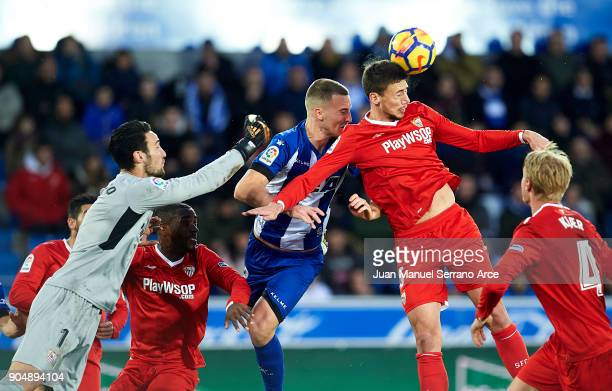 Clement Lenglet of Sevilla FC duels for the ball with John Guidetti of Deportivo Alaves during the La Liga match between Deportivo Alaves and Sevilla...