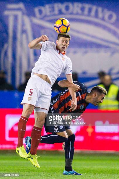 Clement Lenglet of Sevilla FC duels for the ball with Victor Camarasa of Deportivo Alaves during the La Liga match between Deportivo Alaves and...