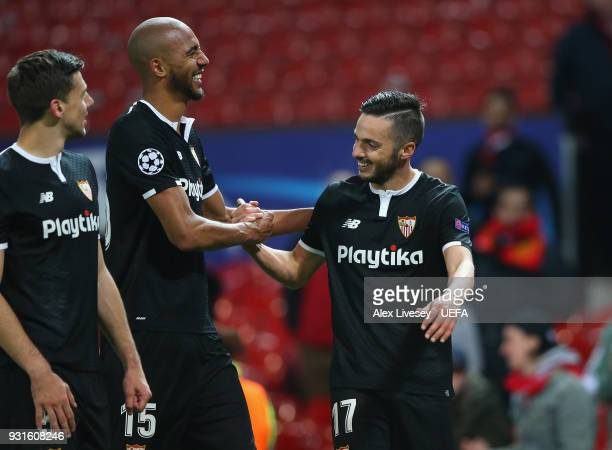 Clement Lenglet Steven N'zonzi and Pablo Sarabia of Sevilla FC celebrate after the UEFA Champions League Round of 16 Second Leg match between...