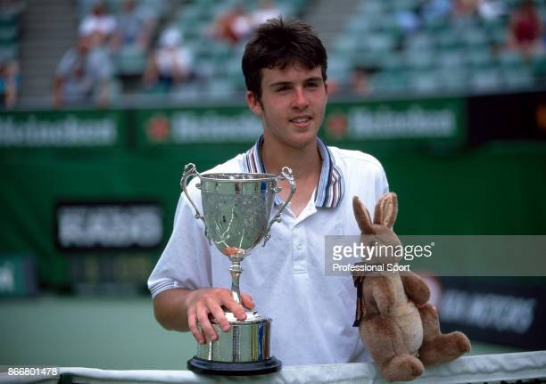 Clement Morel of France poses with the trophy after defeating Todd Reid of Australia in the boys' singles Final of the Australian Open Tennis...