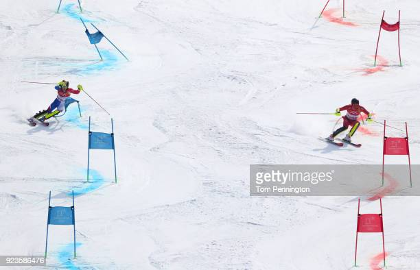Clement Noel of France and Leif Kristian NestvoldHaugen of Norway compete during the Alpine Team Event Small Final on day 15 of the PyeongChang 2018...