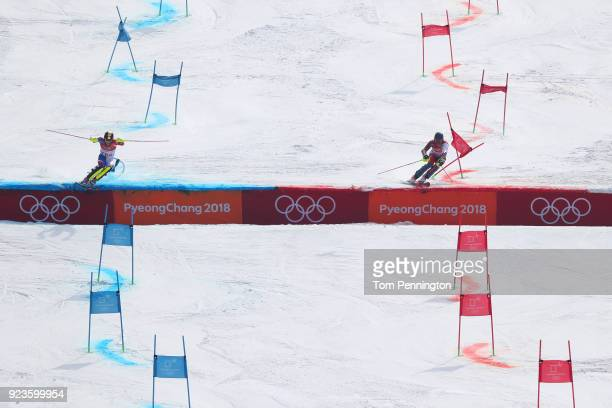 Clement Noel of France and Ramon Zenhaeusern of Switzerland compete during the Alpine Team Event Semifinals on day 15 of the PyeongChang 2018 Winter...