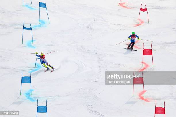 Clement Noel of France and Riccardo Tonetti of Italy compete during the Alpine Team Event Quarterfinals on day 15 of the PyeongChang 2018 Winter...