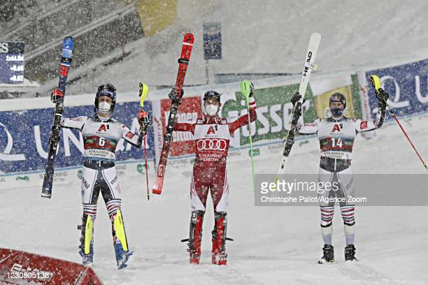 Clement Noel of France takes 2nd place, Marco Schwarz of Austria takes 1st place, Alexis Pinturault of France takes 3rd place during the Audi FIS...