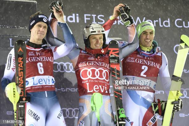 Clement Noel of France, winner Henrik Kristoffersen of Norway and third placed Daniel Yule of Switzerland pose on the podium after the FIS Alpine Ski...
