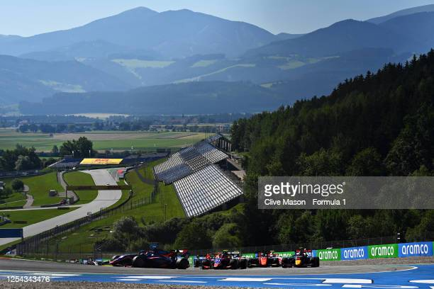 Clement Novalak of Great Britain and Carlin Buzz Racing drives leads the field into turn three at the start during the sprint race for the Formula 3...