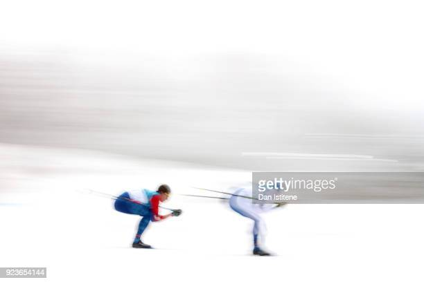 Clement Parisse of France and Matti Heikkinen of Finland compete during the Men's 50km Mass Start Classic on day 15 of the PyeongChang 2018 Winter...