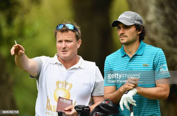 Clement Sordet of France and his caddie look on from the tee during the first round on day one of the Trophee Hassan II at Royal Golf Dar Es Salam on...