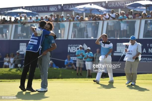 Clement Sordet of France celebrates victory on the 18th green with his caddie during the final round of the NBO Golf Classic Grand Final at Al Mouj...