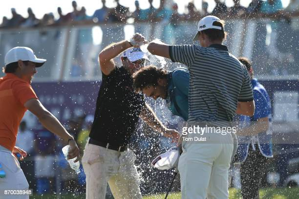Clement Sordet of France gets a soaking after his victory on the 18th green during the final round of the NBO Golf Classic Grand Final at Al Mouj...