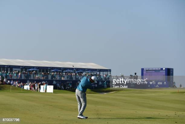 Clement Sordet of France hits an approach shot to the 18th green during the final round of the NBO Golf Classic Grand Final at Al Mouj Golf on...