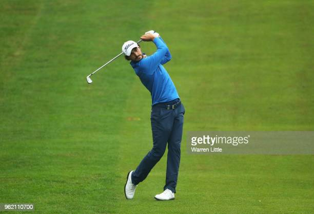Clement Sordet of France plays his second shot on the 4th hole during day one of the BMW PGA Championship at Wentworth on May 24 2018 in Virginia...