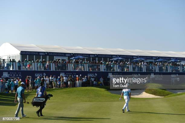 Clement Sordet of France walks to the 18th green with Oliver Lindell of Finland during the final round of the NBO Golf Classic Grand Final at Al Mouj...
