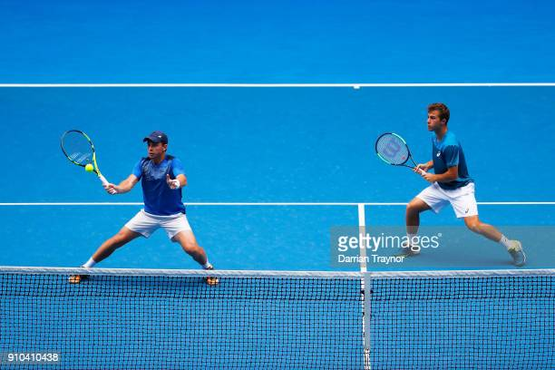 Clement Tabur of France and Hugo Gaston of France compete in the boy's doubles final against Rudolf Molleker of Germany and Henri Squire of Germany...