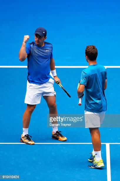 Clement Tabur of France celebrates winning a point in the boy's doubles final with Hugo Gaston of France against Rudolf Molleker of Germany and Henri...
