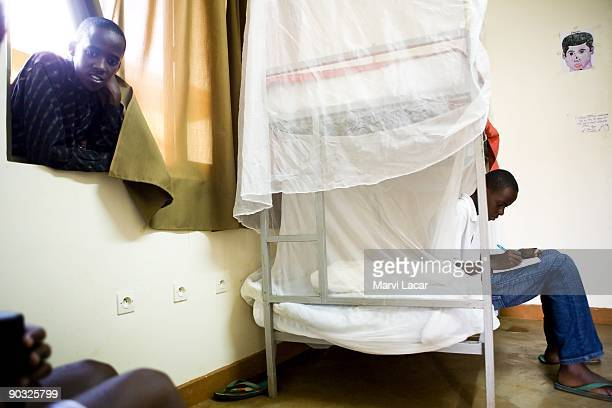 Clemente Ndikumana and Simbi Origene take a break inside the boys dorm after school at the Agahozo Shalom Youth Village on March 12 2009 in Rwamagana...