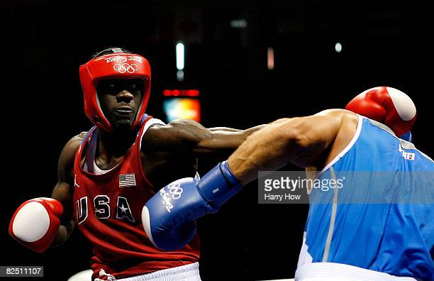 Clemente Russo of Italy fights Deontay Wilder of the United States in the Men's Heavy Semifinal at the Workers' Indoor Arena on Day 14 of the Beijing...