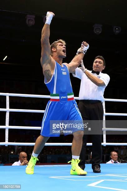Clemente Russo of Italy reacts after he was declared the winner against Teymur Mammadov of Azerbaijan during the Men's Heavy Boxing bout on Day 14 of...