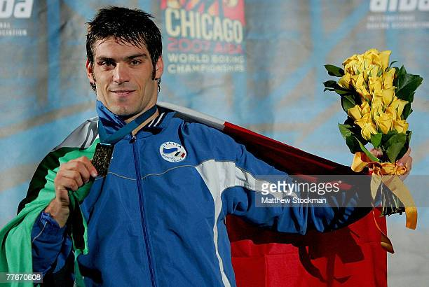 Clemente Russo of Italy stands on the victory podium after his win over Rakhim Chakhkeiv of Russia in the 91 kg division during the finals of the...
