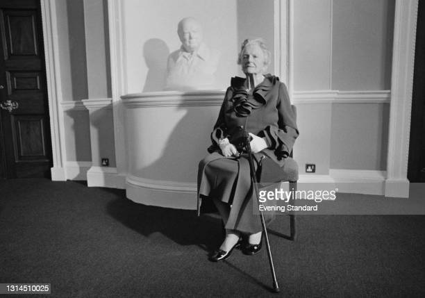 Clementine Churchill, Baroness Spencer Churchill , the widow of former British Prime Minister Winston Churchill, with a bust of her late husband, UK,...