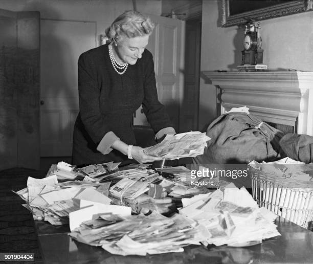 Clementine Churchill the wife of British Prime Minister Winston Churchill deals with letters in response to her appeal on behalf of the Red Cross Aid...
