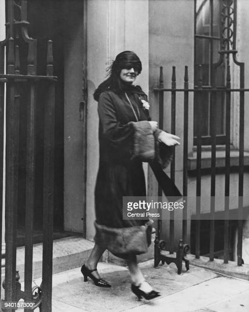 Clementine Churchill the wife of Chancellor of the Exchequer Winston Churchill leaves Downing Street to listen to her husband's budget speech of 1925