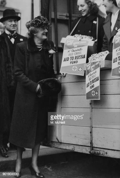 Clementine Churchill the wife of Prime Minister Winston Churchill visits the Aid for Russia depot at Derry Toms in Kensington London and chats with...