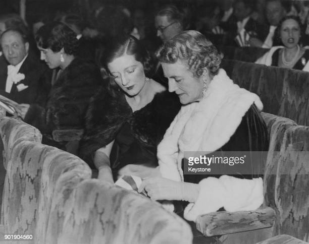 Clementine Churchill the wife of Winston Churchill and her daughter Diana DuncanSandys attend the first night of C B Cochran's new show 'Follow the...