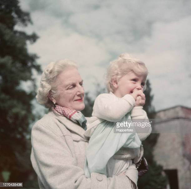 Clementine Churchill , wife of former Prime Minister Winston Churchill, holds her grandaughter Arabella Churchill in the grounds of Chartwell country...