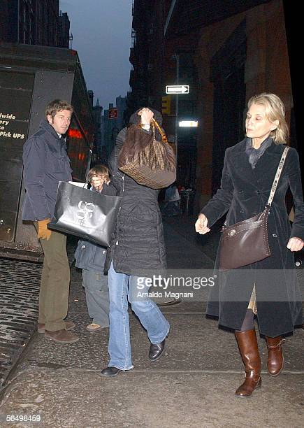 Clementine Igou covers her face as she walks down the street on December 28 2005 in New York City