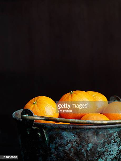 clementines in a copper bucket - ミカン ストックフォトと画像