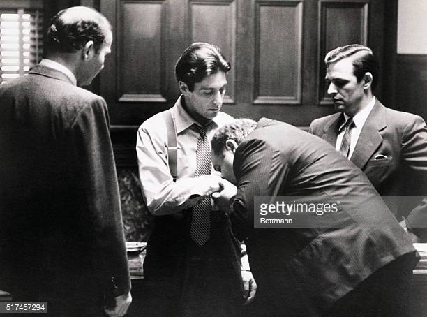 Clemenza kisses the hand of the new Godfather Michael Corleone in the last scene of The Godfather