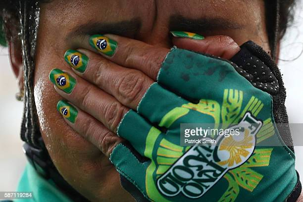 Clemilda Fernandes Silva of Brazil reacts after finishing the Women's Road Race on Day 2 of the Rio 2016 Olympic Games at Fort Copacabana on August 7...