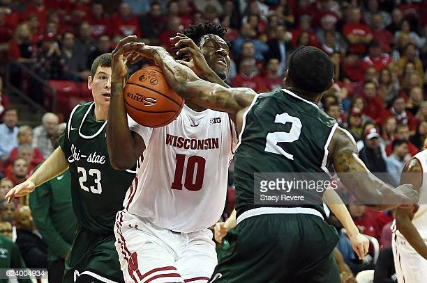 Clemmye Owens V of the Chicago State Cougars blocks a shot by Nigel Hayes of the Wisconsin Badgers during the first half of a game at the Kohl Center...