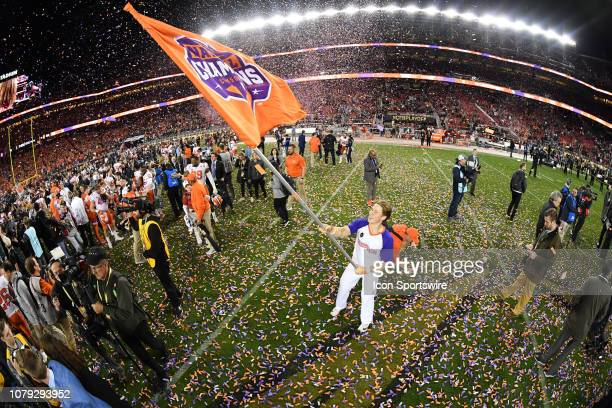 Clemson cheerleader celebrates with a national championship flag after the Clemson Tigers defeated the Alabama Crimson Tide in the College Football...