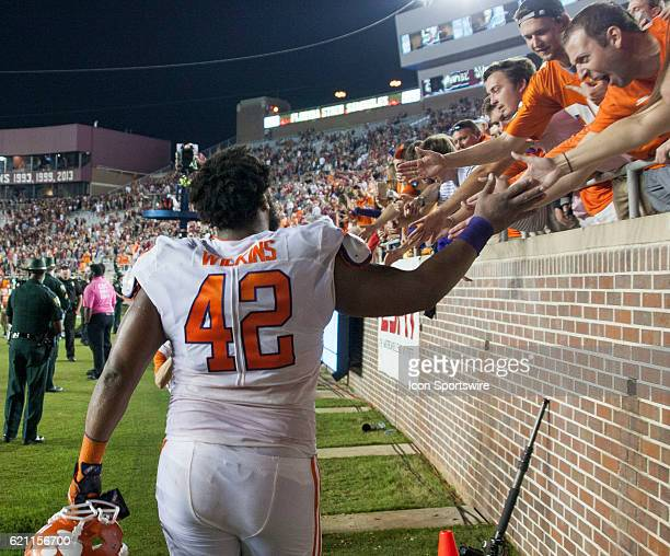 Clemson defensive lineman Christian Wilkins high fiving fans after an NCAA football game between the Florida State Seminoles and the Clemson Tigers...