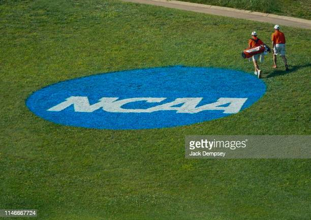 Clemson golfer walks by the NCAA Photos via Getty Images logo painted on the grass during the Division I Men's Golf Stroke Play Championship held at...